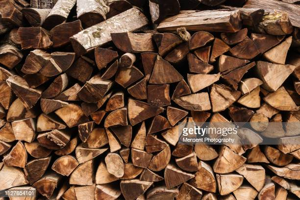 log wood background - firewood stock pictures, royalty-free photos & images