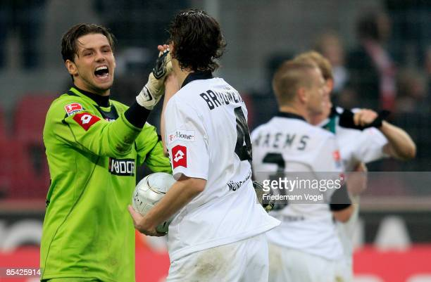 Logan Bailly and Roel Brouwers of M'gladbach celebrate after winning the Bundesliga match between 1. FC Koeln and Borussia Moenchengladbach at the...