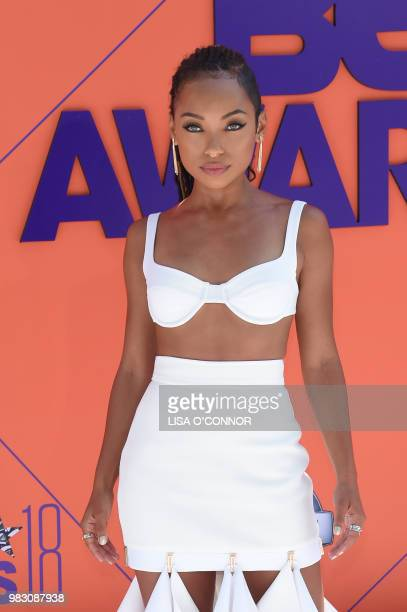 Logan Browning poses upon arrival for the BET Awards at Microsoft Theatre in Los Angeles California on June 24 2018