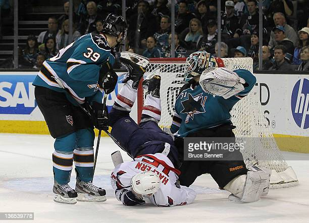 Logan Couture and Antti Niemi of the San Jose Sharks combine to stop Jeff Halpern of the Washington Capitals at the HP Pavilion at San Jose on...
