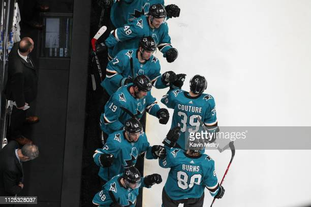 Logan Couture and Brent Burns of the San Jose Sharks celebrate scoring a goal against the Vancouver Canucks at SAP Center on February 16 2019 in San...