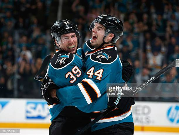 Logan Couture and MarcEdouard Vlasic of the San Jose Sharks celebrate Coutures's gamewinning goal against the Dallas Stars during an NHL game on...