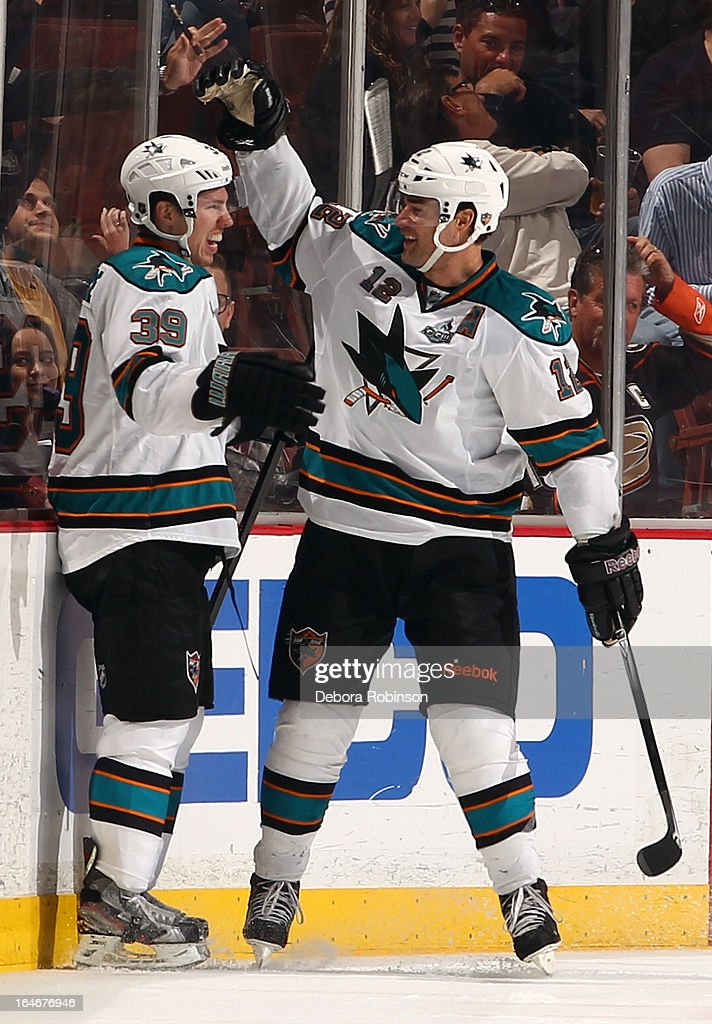 Logan Couture #39 and Patrick Marleau #12 of the San Jose Sharks celebrate during the game against the Anaheim Ducks on March 25, 2013 at Honda Center in Anaheim, California.