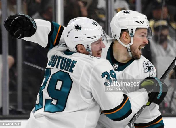 Logan Couture and Tomas Hertl of the San Jose Sharks celebrate after Hertl scored a gamewinning shorthanded goal against the Vegas Golden Knights at...