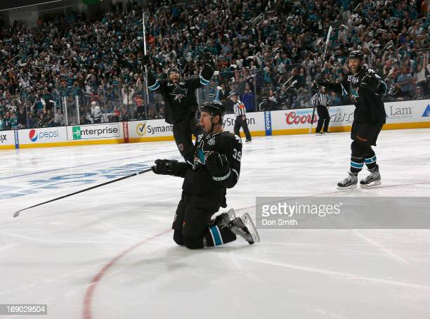 Logan Couture Brent Burns and Joe Thornton of the San Jose Sharks celebrate Couture's gamewinning overtime goal against the Los Angeles Kings in Game...
