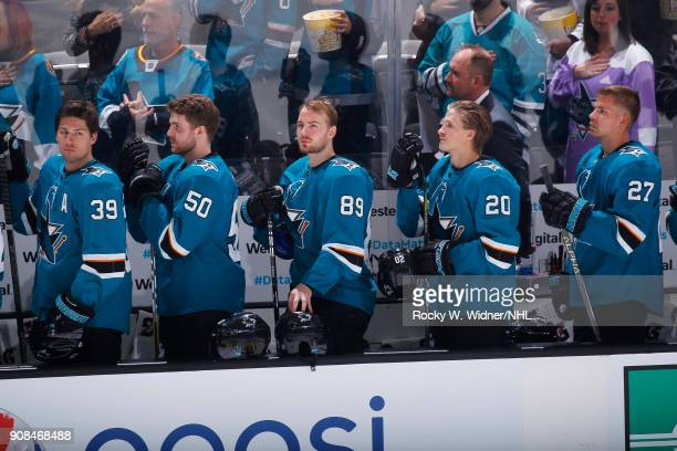 Logan Couture Chris Tierney Mikkel Boedker Marcus Sorensen and Joonas Donskoi of the San Jose Sharks stand for the national anthem of the game...