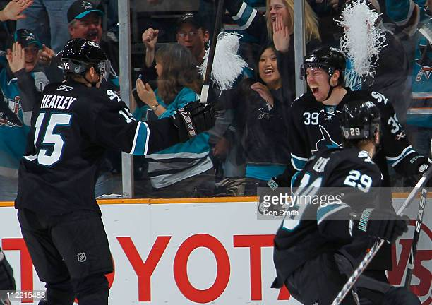 Logan Couture, Dany Heatley, and Ryane Clowe of the San Jose Sharks celebrate Couture's second period goal against the Los Angeles Kings in Game 1 of...