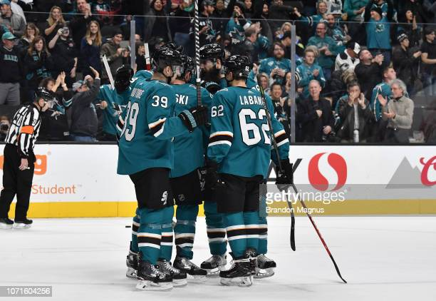 Logan Couture Joe Pavelski Brent Burns and Kevin LaBanc of the San Jose Sharks celebrate scoring a goal against the New Jersey Devils at SAP Center...