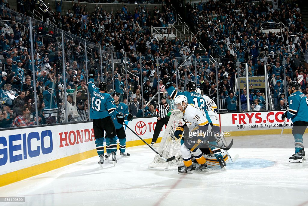 Logan Couture #44, Joe Thornton #19 and Patrick Marleau #12 of the San Jose Sharks celebrate after going up 4-0 against Colton Sissons #10, Mike Fisher #12 and Pekka Rinne #35 the Nashville Predators in game seven of the Western Conference Second Round during the 2016 NHL Stanley Cup Playoffs at the SAP Center at San Jose on May 12, 2016 in San Jose, California.
