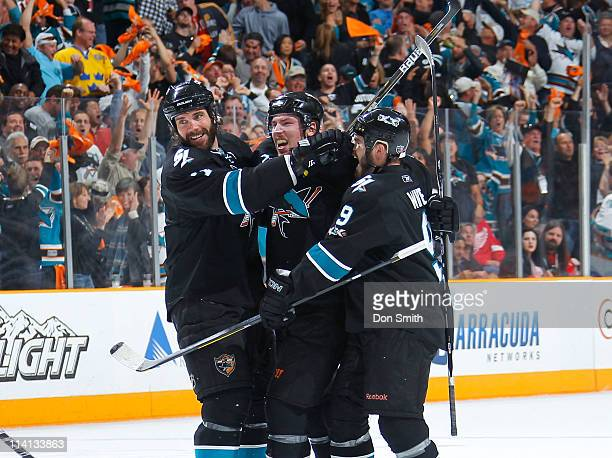 May 12: Logan Couture, Niclas Wallin, and Ian White of the San Jose Sharks celebrate Couture's 1st period goal against the Detroit Red Wings in Game...