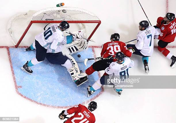 Logan Couture of Team Canada battles for a loose puck as Jaroslav Halak of Team Europe tries to cover up during the World Cup of Hockey tournament at...