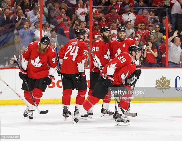 Logan Couture of Team Canada celebrates his period goal against Team USA with Shea Weber Brent Burns Corey Perry and Joe Thornton during a World Cup...