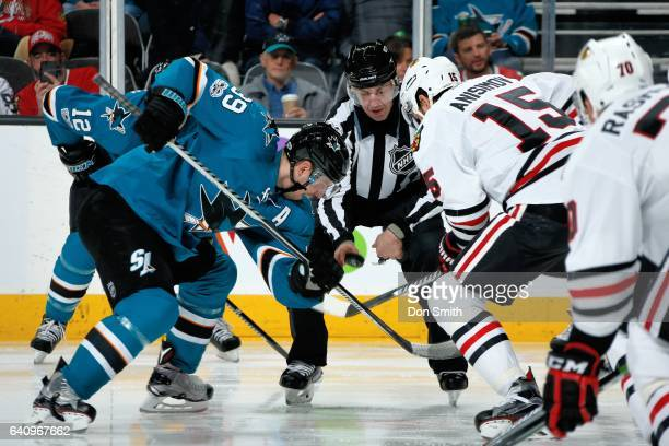 Logan Couture of the San Jose Sharks and Artem Anismov of the Chicago Blackhawks face off at SAP Center at San Jose on January 31 2017 in San Jose...