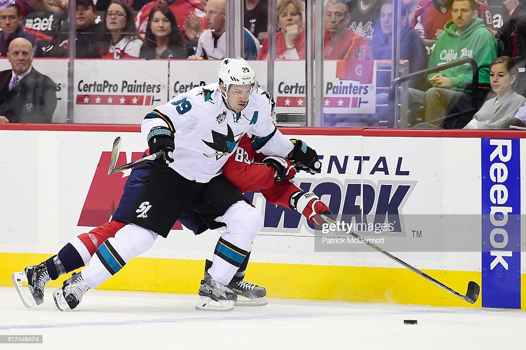 Logan Couture #39 of the San Jose Sharks and Jay Beagle #83 of the Washington Capitals battle for the puck in the first period during an NHL game at Verizon Center on October 13, 2015 in Washington, DC.