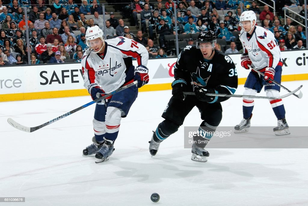Logan Couture #39 of the San Jose Sharks and John Carlson #74 of the Washington Capitals follow the puck during a NHL game at SAP Center at San Jose on March 9, 2017 in San Jose, California.
