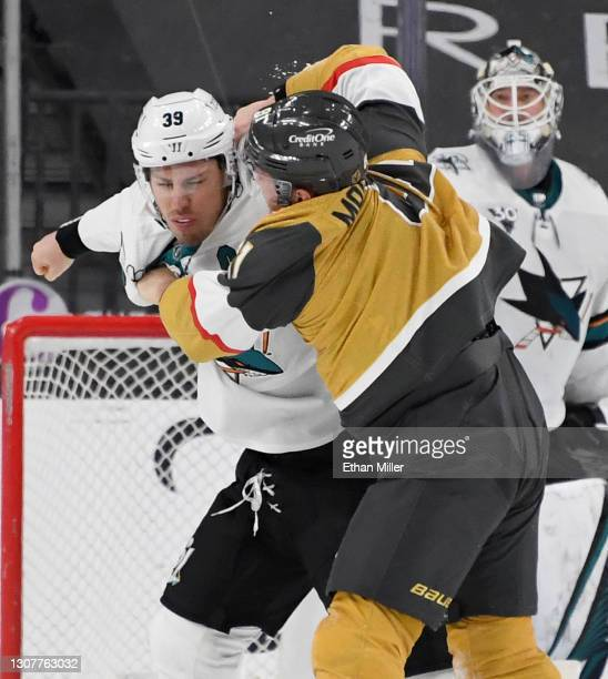Logan Couture of the San Jose Sharks and Jonathan Marchessault of the Vegas Golden Knights fight in the third period of their game at T-Mobile Arena...