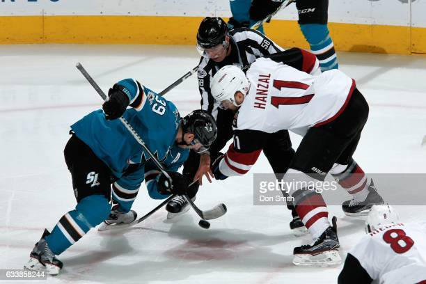 Logan Couture of the San Jose Sharks and Martin Hanzal of the Arizona Coyotes face off at SAP Center at San Jose on February 4 2017 in San Jose...