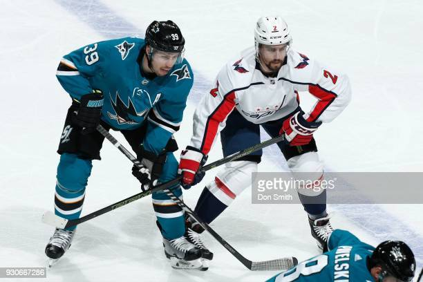 Logan Couture of the San Jose Sharks and Matt Nishkanen of the Washington Capitols get ready at SAP Center on March 10 2018 in San Jose California