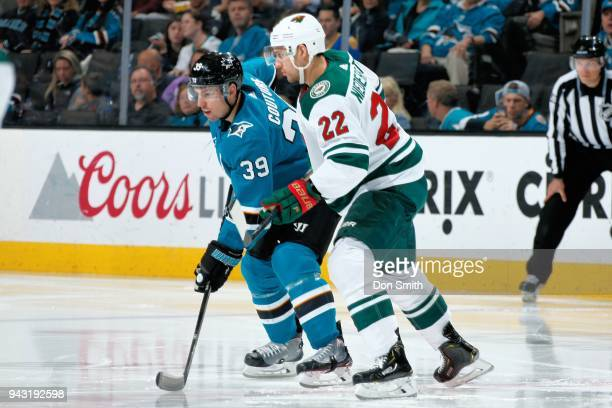 Logan Couture of the San Jose Sharks and Nino Niederreiter of the Minnesota Wild get ready at SAP Center on April 7 2018 in San Jose California