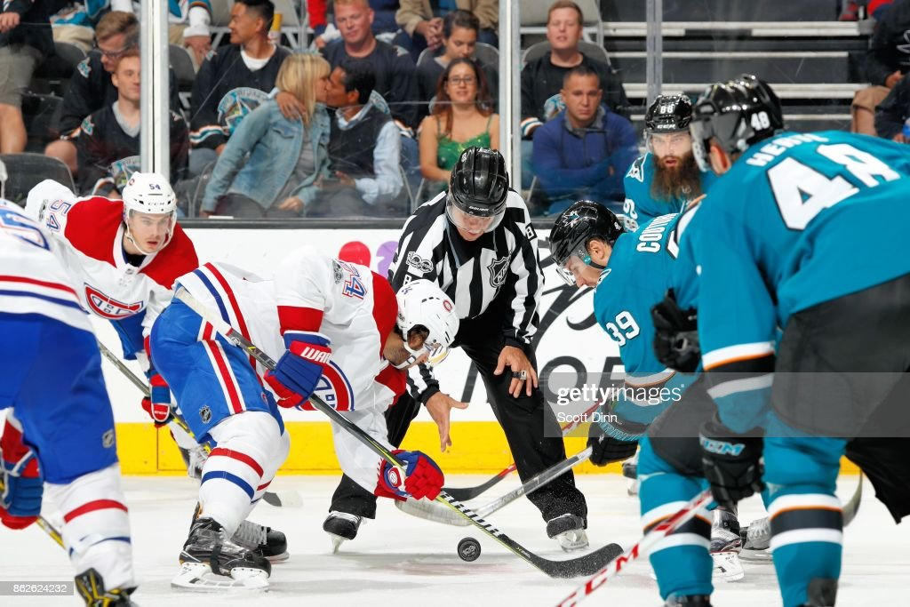 Logan Couture #39 of the San Jose Sharks and Phillip Danault #24 of the Montreal Canadiens faceoff at SAP Center on October 17, 2017 in San Jose, California.