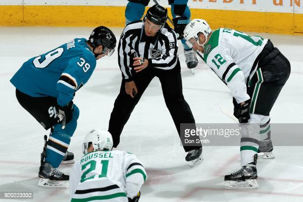 Logan Couture of the San Jose Sharks and Radek Faksa of the Dallas Stars faceoff at SAP Center on February 18 2018 in San Jose California