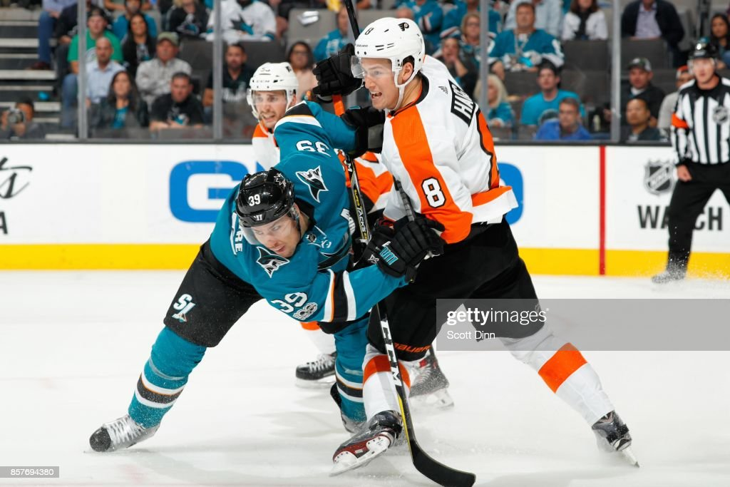 Logan Couture #39 of the San Jose Sharks and Robert Hagg #8 of the Philadelphia Flyers battle on the ice during a NHL game at SAP Center at San Jose on October 4, 2017 in San Jose, California.