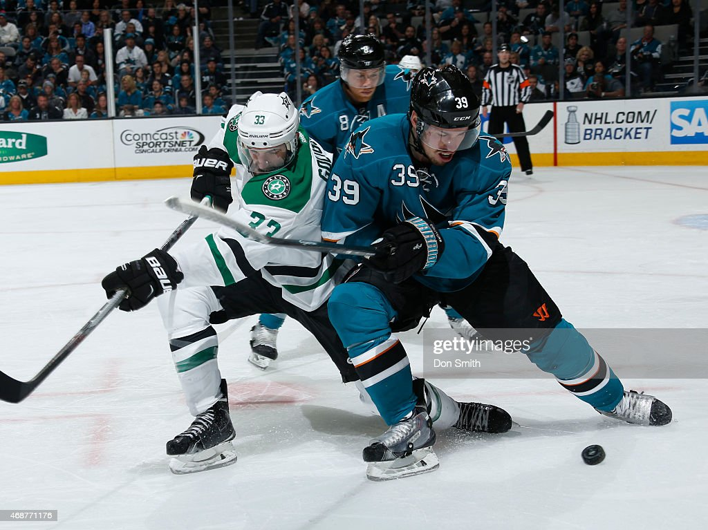 Logan Couture #39 of the San Jose Sharks battles for the puck against Alex Goligoski #33 of the Dallas Stars at the SAP Center on April 6, 2015 in San Jose, California .
