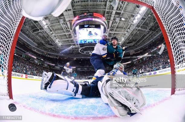Logan Couture of the San Jose Sharks battles in front of the net after Joe Pavelski's goal against Jordan Binnington of the St Louis Blues in Game...