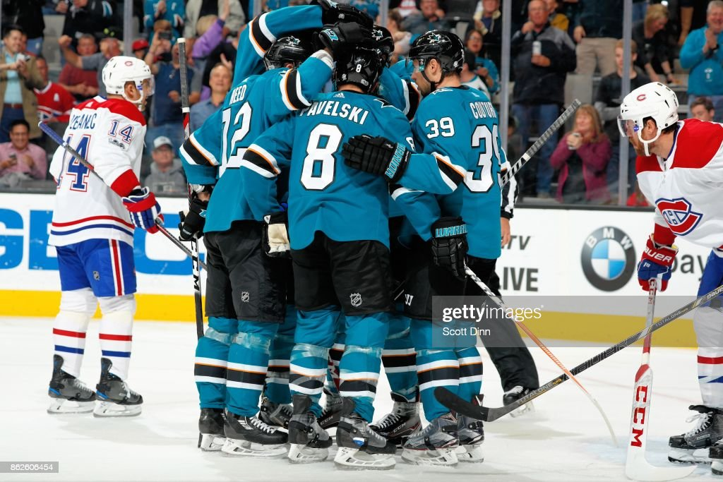 Logan Couture #39 of the San Jose Sharks celebrates his second period goal against the Montreal Canadiens with teammates at SAP Center on October 17, 2017 in San Jose, California.