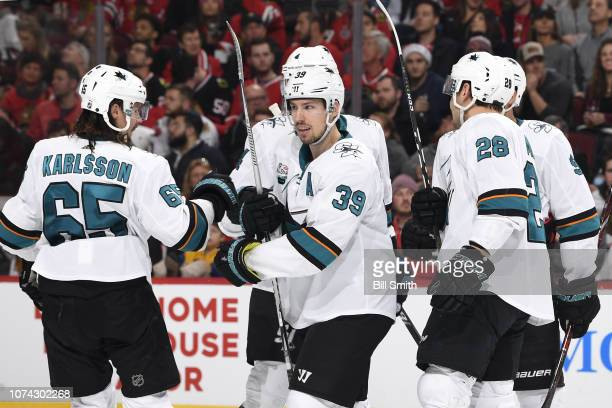 Logan Couture of the San Jose Sharks celebrates with teammates after scoring against the Chicago Blackhawks in the second period at the United Center...