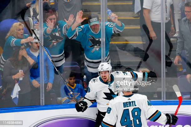 Logan Couture of the San Jose Sharks celebrates with Tomas Hertl after scoring a goal on Jordan Binnington of the St Louis Blues during the third...