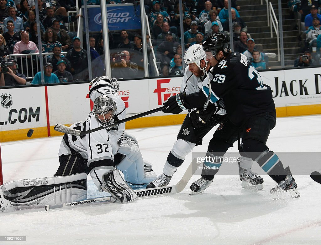 Logan Couture #39 of the San Jose Sharks fires a shot against Jonathan Quick #32 and Rob Scuderi #7 of the Los Angeles Kings in Game Four of the Western Conference Semifinals during the 2013 Stanley Cup Playoffs at HP Pavilion on May 21, 2013 in San Jose, California.