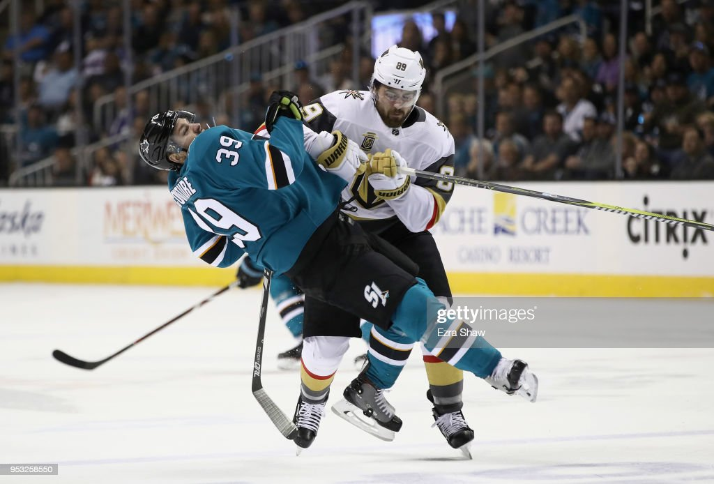 Logan Couture #39 of the San Jose Sharks gets checked by Alex Tuch #89 of the Vegas Golden Knights during Game Three of the Western Conference Second Round during the 2018 NHL Stanley Cup Playoffs at SAP Center on April 30, 2018 in San Jose, California.