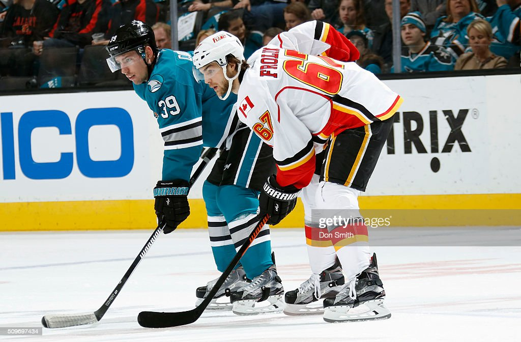 Logan Couture #39 of the San Jose Sharks gets set for a face-off against Michael Frolik #67 of the Calgary Flames during a NHL game at the SAP Center at San Jose on February 11, 2016 in San Jose, California.