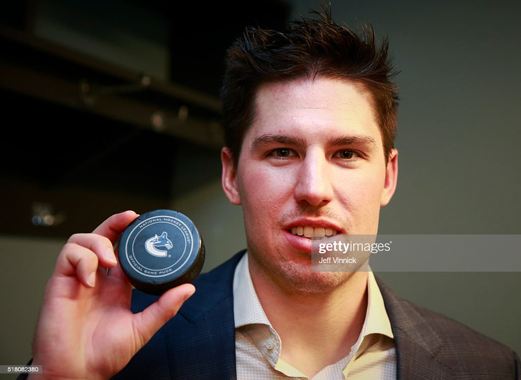 Logan Couture #39 of the San Jose Sharks holds the puck representing his first NHL hat trick scored during their NHL game against the Vancouver Canucks at Rogers Arena March 29, 2016 in Vancouver, British Columbia, Canada. San Jose won 4-1.