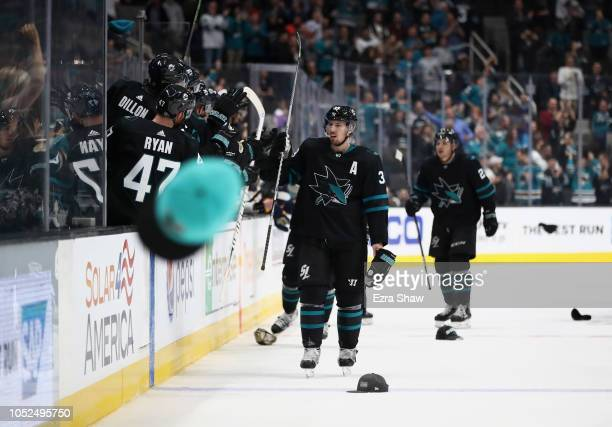 Logan Couture of the San Jose Sharks is congratulated by teammates after he scored a hat trick against the Buffalo Sabres at SAP Center on October 18...