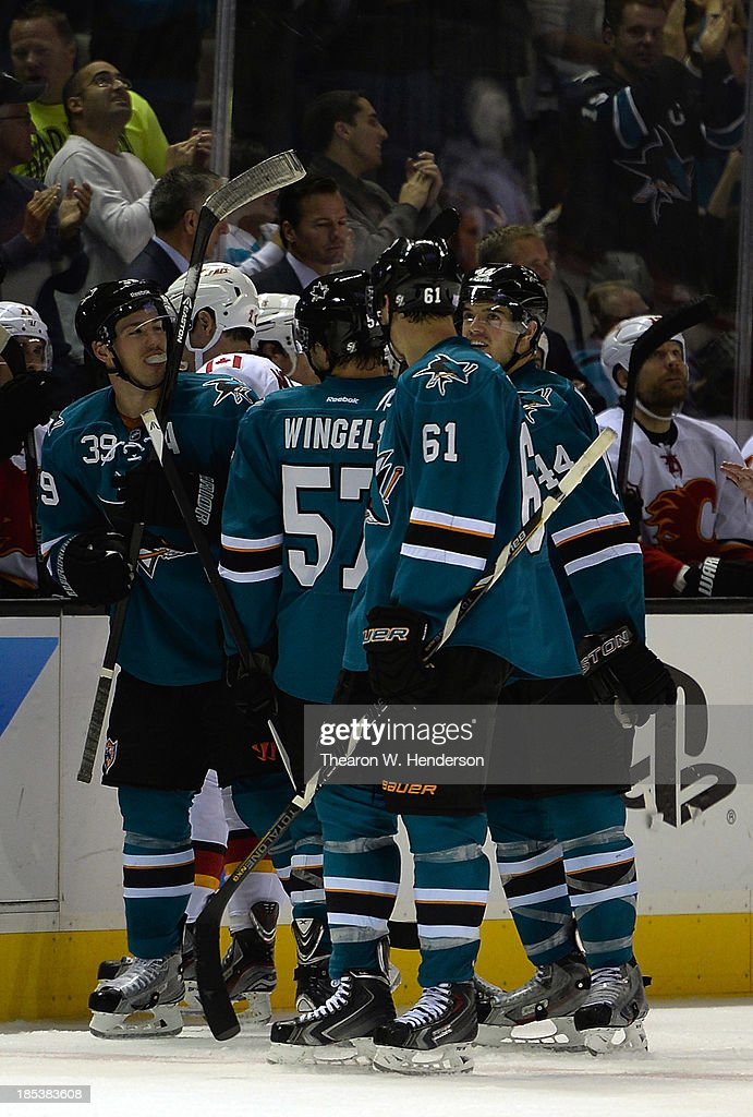 Logan Couture #39 of the San Jose Sharks is congratulated by teammates after he scored on an empty net during the third period against the Calgary Flames at SAP Center on October 19, 2013 in San Jose, California. The Sharks won the game 6-3.