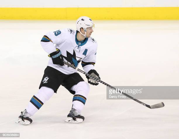 Logan Couture of the San Jose Sharks keeps an eye on the play during first period action against the Winnipeg Jets at the Bell MTS Place on January 7...