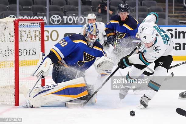 Logan Couture of the San Jose Sharks looks to take a shot on goal against Jordan Binnington of the St. Louis Blues in the second period at Enterprise...