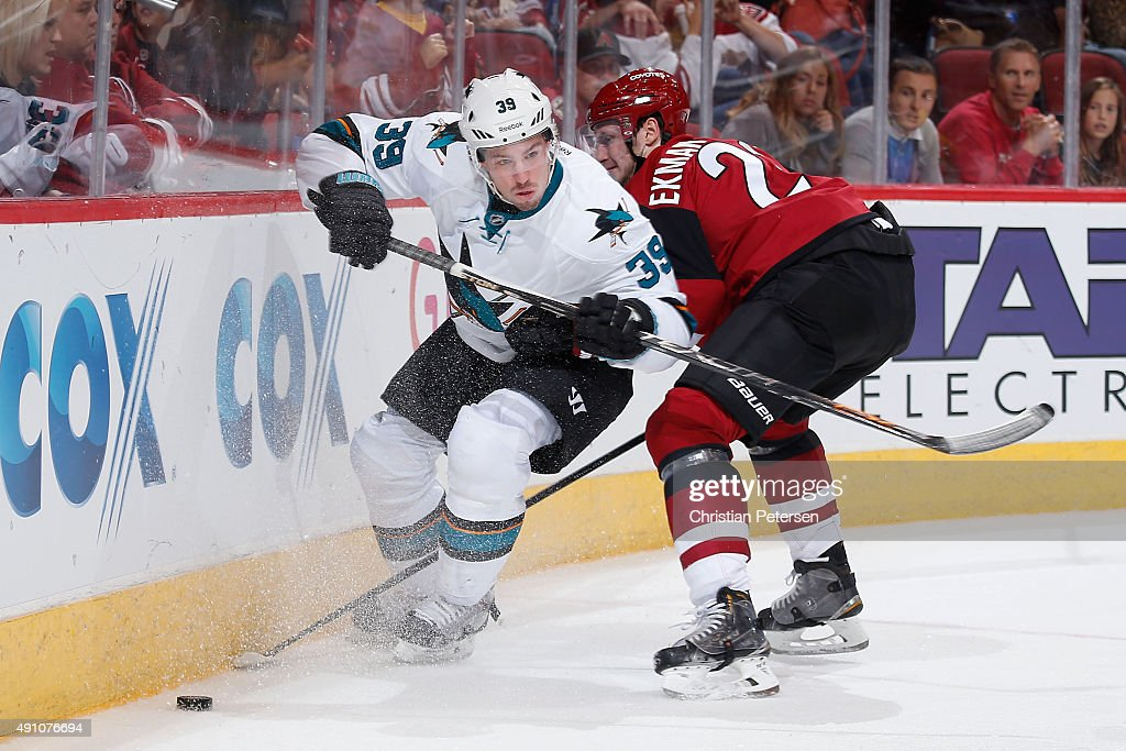 Logan Couture #39 of the San Jose Sharks moves the puck past Oliver Ekman-Larsson #23 of the Arizona Coyotes during the third period of the NHL preseason game at Gila River Arena on October 2, 2015 in Glendale, Arizona. The Sharks defeated the Coyotes 3-0.