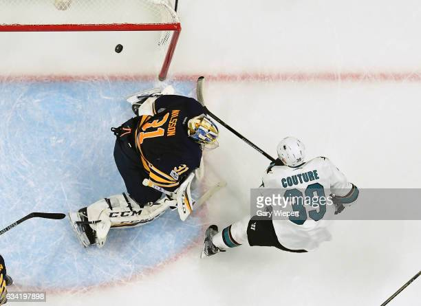 Logan Couture of the San Jose Sharks scores a first period goal against Anders Nilsson of the Buffalo Sabres during an NHL game at the KeyBank Center...