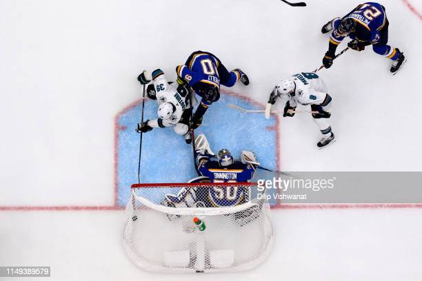 Logan Couture of the San Jose Sharks scores a goal on Jordan Binnington of the St. Louis Blues during the third period in Game Three of the Western...