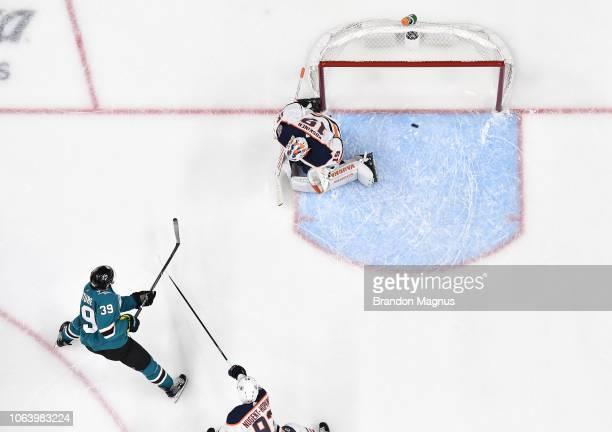Logan Couture of the San Jose Sharks scores a goal past Mikko Koskinen of the Edmonton Oilers at SAP Center on November 20 2018 in San Jose California