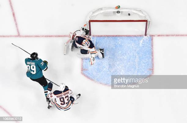 Logan Couture of the San Jose Sharks scores a goal past Ryan NugentHopkins and Mikko Koskinen of the Edmonton Oilers at SAP Center on November 20...