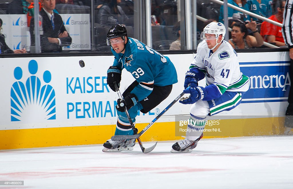 Logan Couture #39 of the San Jose Sharks skates after the puck against Sven Bartsch #47 of the Vancouver Canucks at SAP Center on September 29, 2015 in San Jose, California.