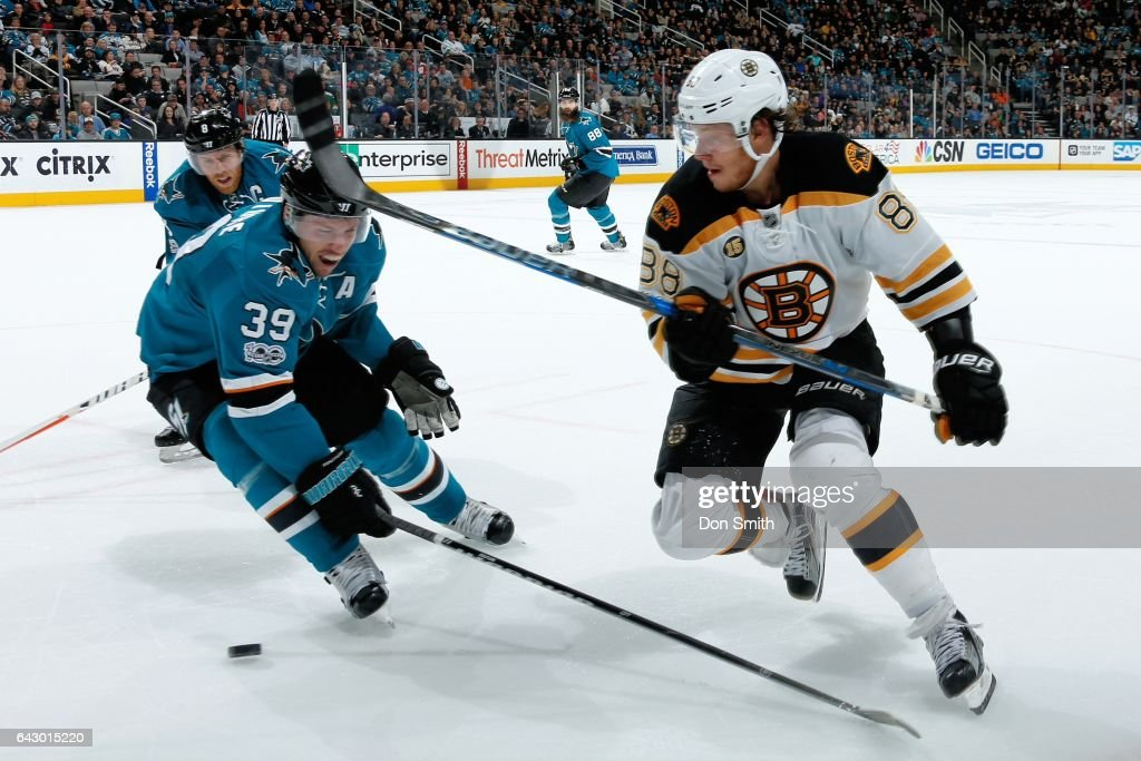 Logan Couture #39 of the San Jose Sharks skates against David Pastrnak #88 of the Boston Bruins at SAP Center at San Jose on February 19, 2017 in San Jose, California.