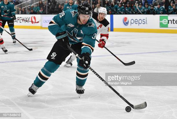 Logan Couture of the San Jose Sharks skates the puck ahead against the New Jersey Devils at SAP Center on December 10 2018 in San Jose California