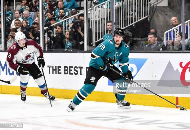 Logan Couture of the San Jose Sharks skates with the puck against Cale Makar of the Colorado Avalanche in Game Seven of the Western Conference Second...