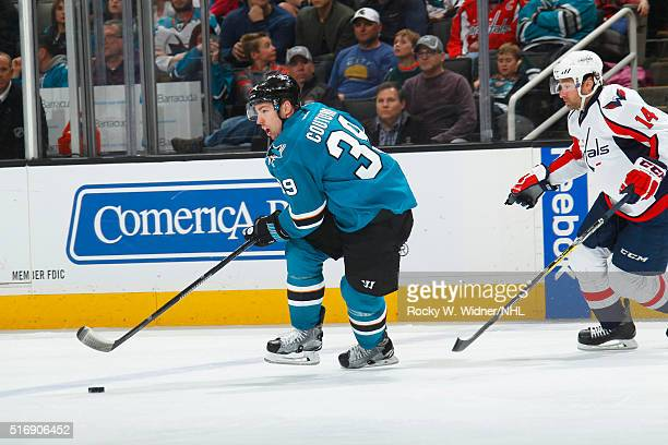 Logan Couture of the San Jose Sharks skates with the puck against Justin Williams of the Washington Capitals at SAP Center on March 12 2016 in San...