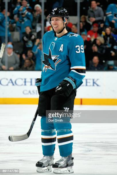 Logan Couture of the San Jose Sharks smiles during a NHL game against the Ottawa Senators at SAP Center on December 9 2017 in San Jose California